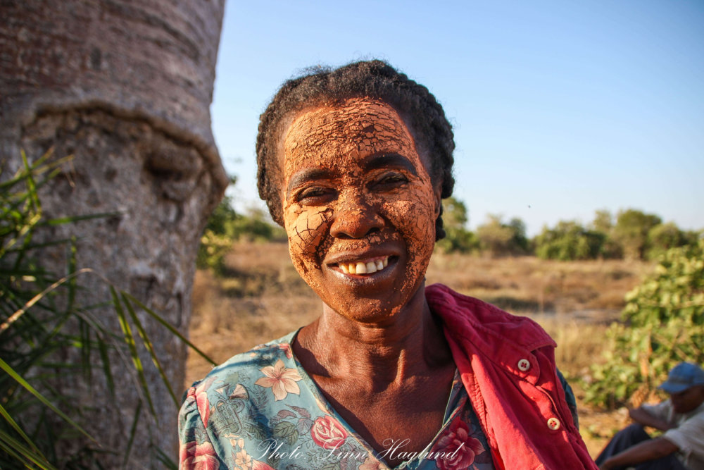Malagasy woman with clay in her face to protect her skin from the sun