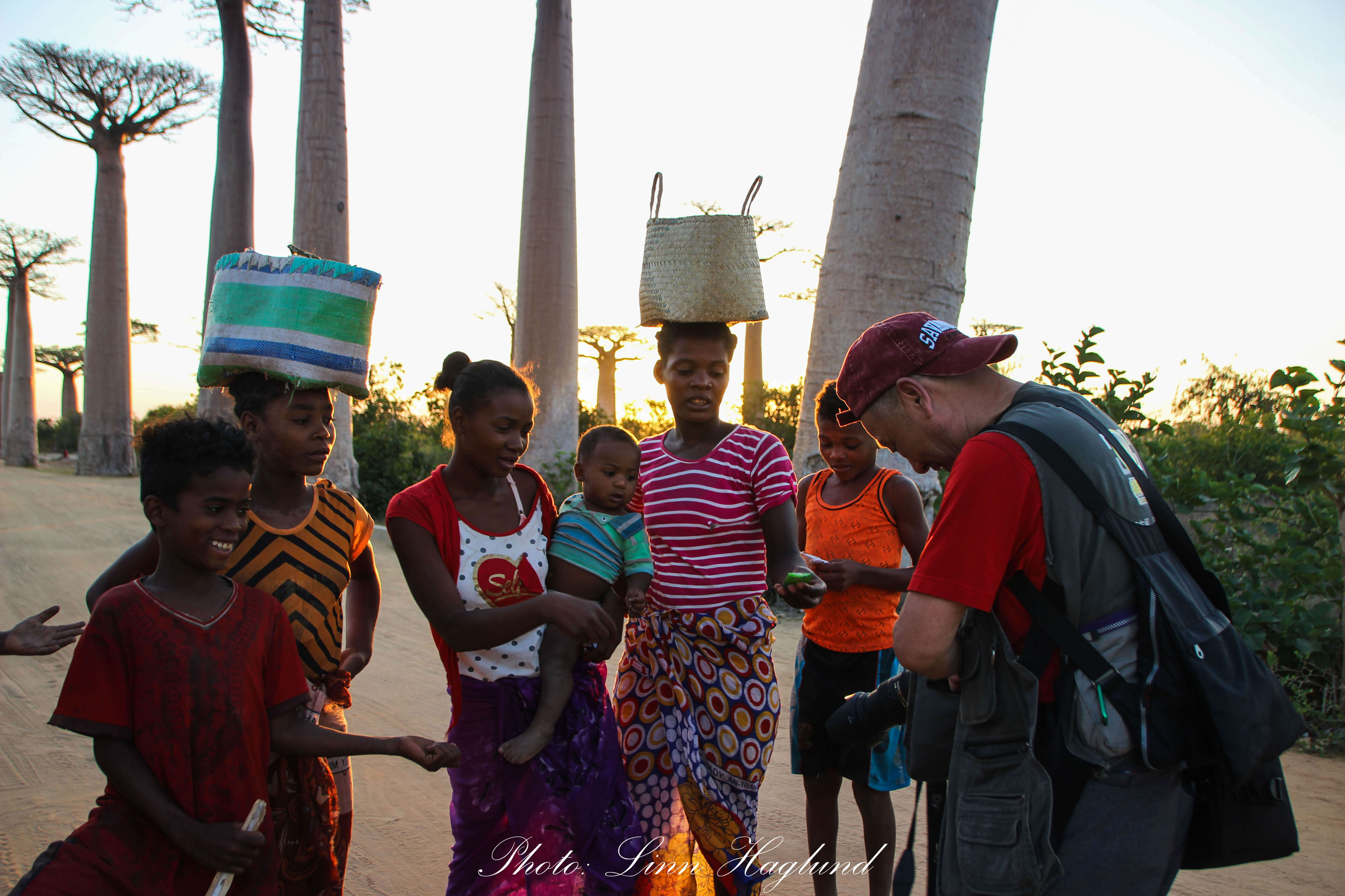 Tourist giving gifts to Malagasys
