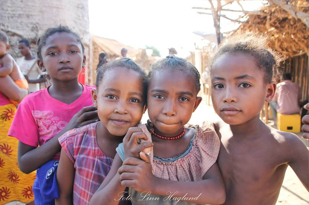 Girls in Madagascar that wanted to be photographed. their mothers are standing ringht next to them.